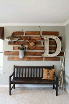Like the idea of the pieces of stained wood on the wall with random decor attached.. above the main couch? Dining room?