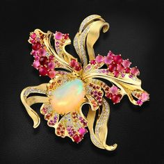 Brooch-pendant with opal, rubies, sapphires, tourmalines and diamonds in yellow gold 750