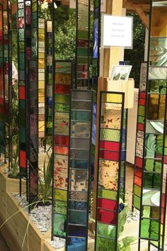 Mirrors & glass in gardens from GardenDrum. Decorative glass panels by Hayhoe Design UK