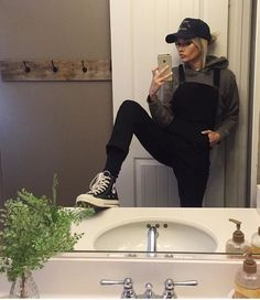 Black overalls + sweatshirt