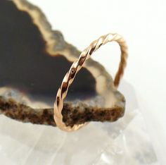 Solid 14k Rose Gold Twisted Stacking Ring by forkwhisperer on Etsy. Pretty!!! I like the stacked ones.