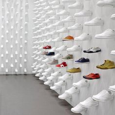 """Camper Together New York by Nendo / Nendo arranged the shoes in a regimented pattern across every wall, intended to look like they are """"walking on air"""". Each identical shoe is a replica of the Camper Pelota, the brand's most iconic footwear collection, and is made from white resin."""