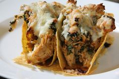 Spicy Chicken Baked Tacos -1 lb cooked/shredded chicken breast -1 jalapeno chopped remove seeds -1 pack taco season -1 box frozen spinach -2 cups medium salsa -2 cups shredded cheese -5 taco shells simmer for 5 minutes, stuff in shells, bake 10 min at 425