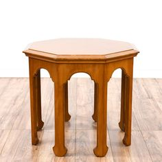 This moroccan style end table is featured in a solid wood with a glossy light cherry finish. This bohemian side table has an octagon table top, intricate carved arches and 8 straight legs. Eclectic piece perfect for the side of a sofa! #bohemian #tables #endtable #sandiegovintage #vintagefurniture