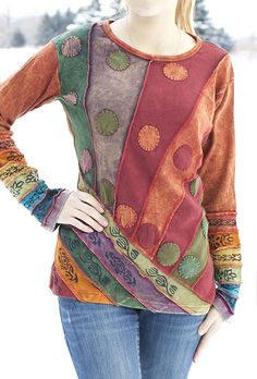 With delightful patchwork detail and a variety of color, this tee is a treasure not to be missed. Our top is perfect to pair with your favorite jeans or a casual skirt. Handmade in & fairly traded from Nepal.