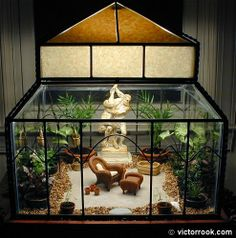A large terrarium or Wardian case I purchased at Lowe's years ago. It's been home to plants, as well as Christmas and Halloween scenes. Large Terrarium, Terrariums, Glass Aquarium, Nifty Crafts, Halloween Scene, Lanterns Decor, Indoor Garden, Herb Garden, Houseplants