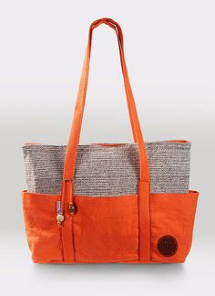 Large, roomy, with lots of pockets. Fits up to 15 in. laptop.    EXTERIOR: 1) Hand spun and hand woven fabric. 100% Natural tone wool weft and 100