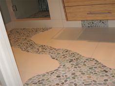 A crash course on installing pebble tile flooring. Tips and tricks on how to make the seams disappear, what kind of grout to use, and other techniques