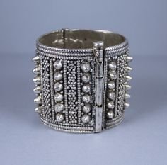 A beautiful Yemeni cuff from the 1970s, in high grade silver with granulation, appliques, and spikes.  The gentleman who collected it described Yemeni silversmiths still working by candlelight in the 1970s.