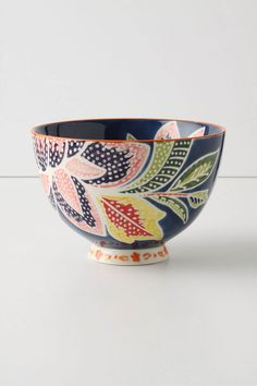 """Ever-bright flora blaze against a solid curve of stoneware. - Stoneware - Dishwasher and microwave safe - 26 oz - 4""""H, 6"""" diameter - Imported"""