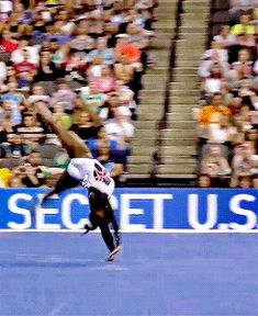 Simons Biles I think this move is called the Biles named after her (gif of Simone Biles' Biles)