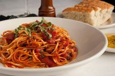 Pasta Pomodoro - vermicelli tossed with diced tomatoes, capers, garlic, and fresh herbs in an olive oil-marinara sauce