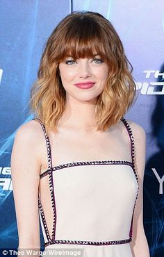 Emma Stone. The 25-year-old starlet officially debuted her new ombré fringe bob while posing outside the Ziegfeld Theater (pictured on right Monday)
