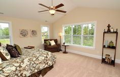 Master bedroom with vaulted ceiling.