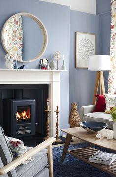 Transform your fireplace and make it more heat efficient with a wood burning stove. Photography: Joanna Henderson. Find more living room ideas at housebeautiful.co.uk