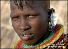 Photograph of Close up portrait of Turkana girl with traditional hairstyle and bead decorations, Loyangalani, Kenya photos