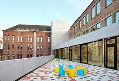 Built by Burobill,ZAmpone architectuur in Brussel, Belgium with date 2015. Images by Filip Dujardin. This Child Day Care Center will house 68 children in the center of Brussels. There is limited space available in this...