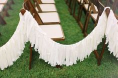 fringe garland down aisle...great alternative to flower markers that will only be used for a a short ceremony!