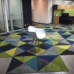 FLOR / Multiple Styles and Colors / Calidad Inmobiliaria / Guatemala City, Guatemala / The mix of styles and colors in the rug adds to the modern vibe of this office space!