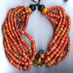 Africa | Thick necklace multi strand coral brass center, from Ait Atlas.  Coral, amber, jet, amazonite and brass. | © Linda Pastorino