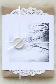 Wrap a gift in plain paper, top with a doily and a copy of a favorite image #giftwrap #doily #photo