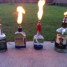 We made these tiki torches from old liquor bottles! They work great, I love them!
