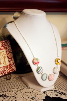 LOVE this idea: crafting baby clothes into pendants for a keepsake necklace!