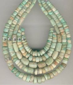 Nicely graduated strands of ancient Amazonite in matching shapes