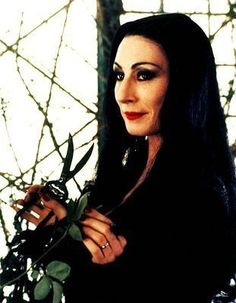 Anjelica Huston as Morticia Addams Morticia Addams Dress, Morticia Adams, Gomez And Morticia, Die Addams Family, Addams Family Values, The New Yorker, Los Addams, Charles Addams, Mom Costumes