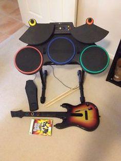 Xbox 360 Guitar Hero World Tour Bundle - Drum set w/ drum sticks, Red Octane guitar, microphone