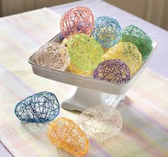 Colorful string eggs are an easy Easter craft.