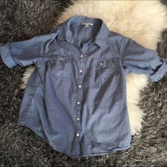 Croft&barrow chambray button down Says it's a XL but I think it would fit best on a medium. I'm an Xs and it fits me a little oversized. Croft & Barrow Tops Button Down Shirts