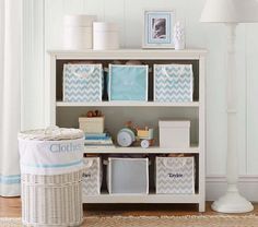 Outfit a shelving unit with canvas bins for customized toy storage