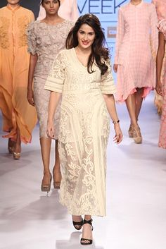 Sagarika Ghatge for Pallavi Singhee at the Lakme Fashion Week. To view, visit: http://www.vogue.in/content/bollywood-showstoppers-lakme-fashion-week-summer-resort-2015#22