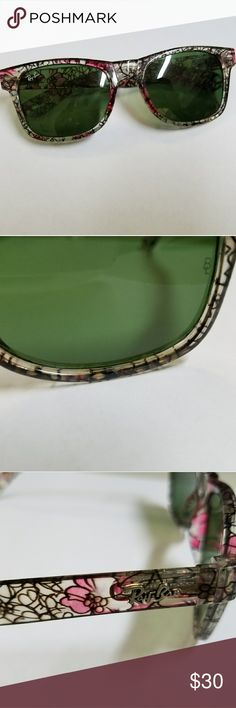 Floral Wayfarer Ray Ban Sunglasses Transparent floral Ray Ban Sunglasses. Good condition. One small scratch about 1/10 inch, tried to take a picture of it but it's so tiny it barely shows. Scratch does not affect vision. No trades. Ray-Ban Accessories Sun