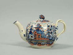 Lot 260 - A late 18c pearlware teapot of globular form profusely decorated in the Oriental style with pagodas. 5 ins high.