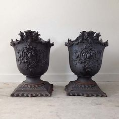 """Pair of American Rococo Cast Iron Urns, 19th century.  15""""l x 23""""h x 15""""d"""