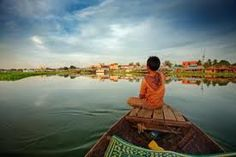 looking out of a boat in Cambodia