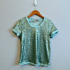 Forever 21 Sequined Top Green sequined top from Forever 21 Love 21. Has a silky feeling lining. NWT.  | Measurements | Size: Small  | Materials | Shell: 100% nylon. Lining: 95% polyester, 4% spandex.  Make me an offer! Bundling discounts always available! Forever 21 Tops Blouses
