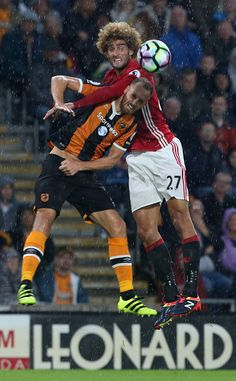 Marouane Fellaini of Manchester United in action with David Meyler of Hull City…
