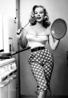Pin-up model Betty Brosmer c. 1950s how to properly cook an omelet plus have body measurements that defy the laws of nature.  bombshell indeed.