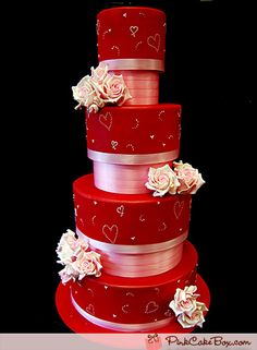 Valentine's Day Wedding Cake: Decorated with red fondant and pink details, each cake tier includes hand piped whimsy hearts. The cake batter is pink velvet with raspberry buttercream.