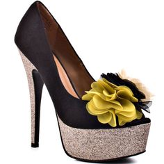 Your number one priority will be to own this adorable pumps from ZiGi!  Priority features a luxurious black suede upper and a glitzy glitter covered 6 inch heel and 1 1/2 inch platform.  Creating the perfect accent is a gorgeous bushel of fabric flowers at the vamp.