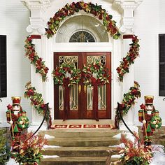 Festive garlands adorn the stately entrance. Elegant Christmas, Beautiful Christmas, Christmas Holidays, Christmas Ideas, Outdoor Christmas Decorations, Holiday Decor, Outdoor Decor, Happy Holidays Greetings, Christmas Front Doors