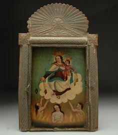 Nuestra Señora de Carmen (Our Lady of Mt. Carmel) is depicted in this colorful 19th century Mexican folk retablo painting. In the lower quadrant, three 'anima solas,' departed ancestral souls awaiting judgement in the flames of purgatory, plead for her mediation. The retablo is displayed in the original 19th century tin nicho frame - a work of art in itself.