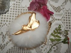 This necklace has a rabbit's jawbone, painted in gold color.   ♥No animals were killed for the purpose of creating these items. I didn't killed, nor harmed the rabbit. It was found dead near its pen. I would never hurt any sentient being.♥  ***Please keep it away from water & humid places. Do...