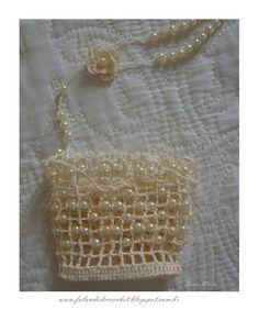 https://falandodecrochet.blogspot.com.br/2012/09/croche-com-pedrarias-perolas.html