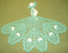 New Hand Crocheted Crinoline Lady Doily Aqua & White. Found this completed doily for sale on eBay for $12.75. For inspiration.