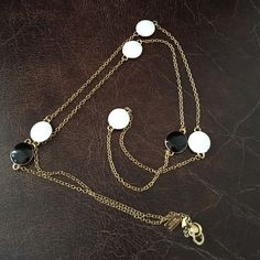 Kate Spade Necklace - Black/white with gold Beautiful!  Kate Spade Necklace. Gold chain with black/white circles - circles are back on one side, white on the other. Circle diameter is approx 1/2 inch. Necklace is approx 35 inches long. Never worn. Comes with Kate Spade jewelry dust bag. kate spade Jewelry Necklaces