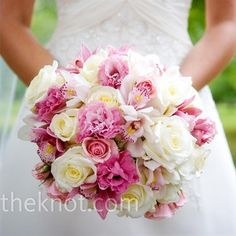 """Print   6  Kelly worked closely with her florist to create the wedding flowers, which were inspired by images the bride found that """"reminded me of an English garden."""" The bride's lush, textured bouquet included white hydrangeas and roses, blush pink roses, and mauve cymbidium orchids."""